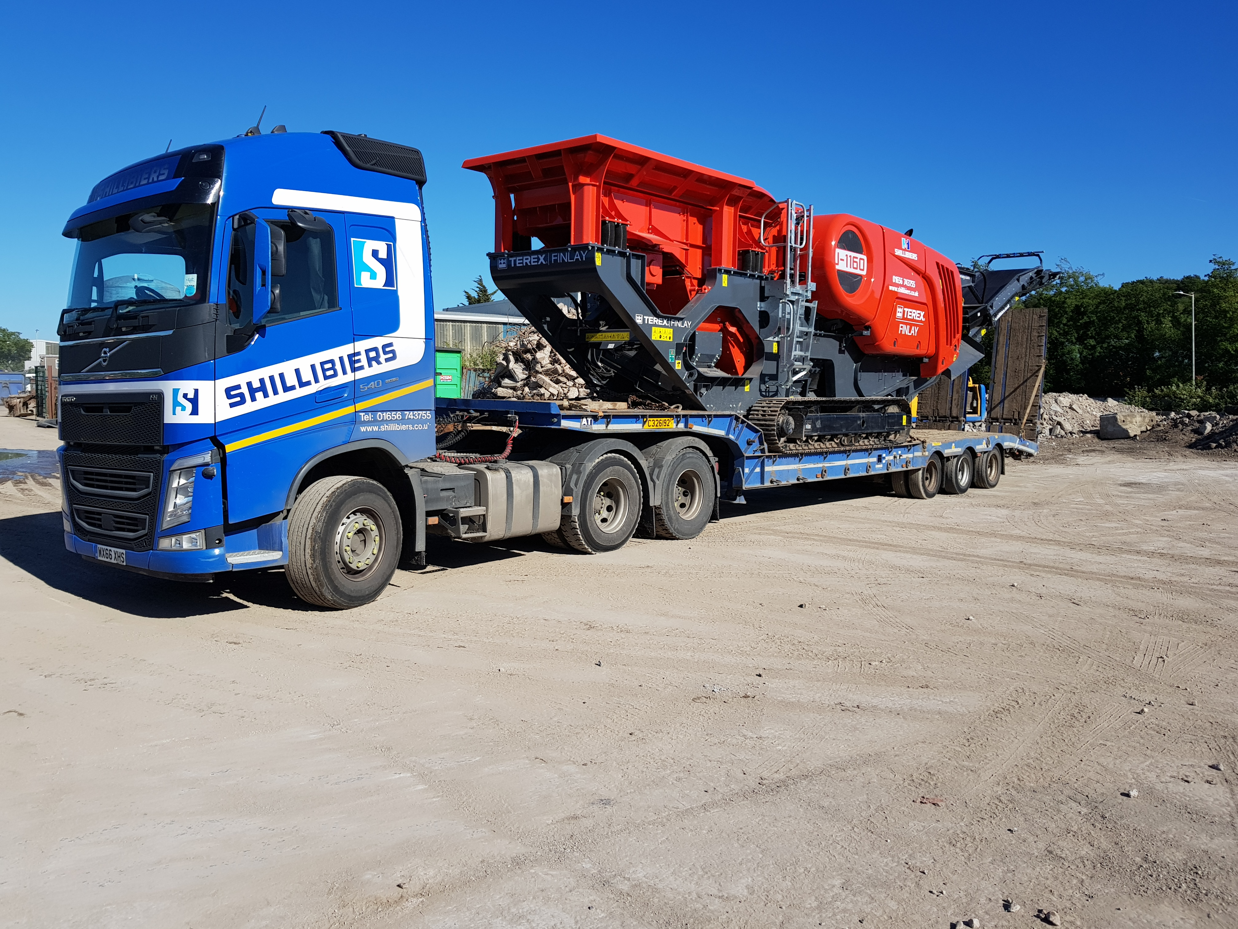 Low loader and crusher.jpg